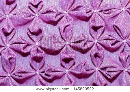 Abstract textile in interior. Purple fabric background.