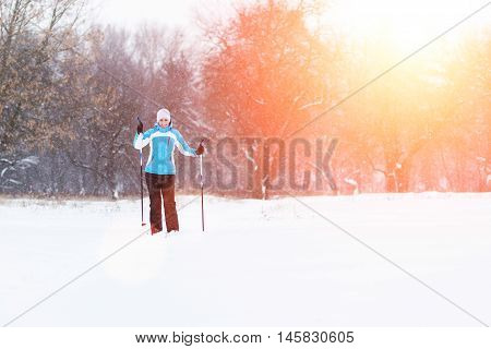 Young Woman Rest After Ski Running In Winter Park