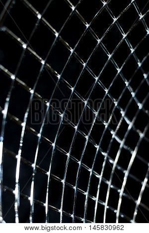 Abstract net background on black background. Metal perpendicular lines