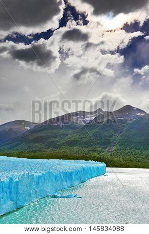 Colossal Perito Moreno glacier in Lake Argentino. Los Glaciares National Park in Argentina. Sunny and windy summer day