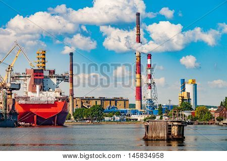 View wharf shipyard with high chimneys in the background in Gdansk Poland.