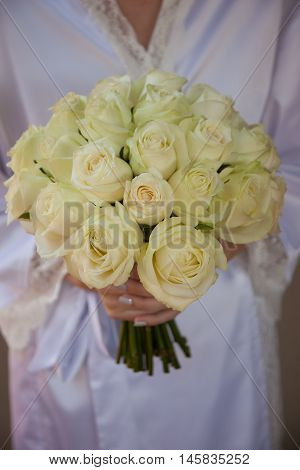 Wedding bouquet with cream roses shallow dept of field