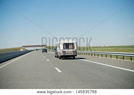 MARSEILLE FRANCE - MAY 05 2016: Eriba RV van and trailer driving fast to vacance destination on highwayon a summer day