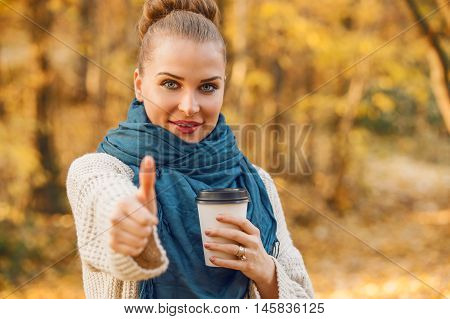 Attractive Woman Drinking Coffe And Showing Thumbup