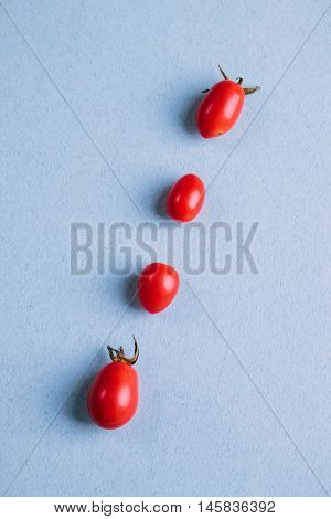 Red Cherry Tomatoes On A Blue Table