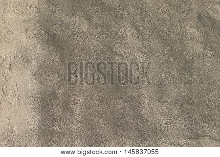Gray plaster wall with uneven surface texture as a retro pattern layout