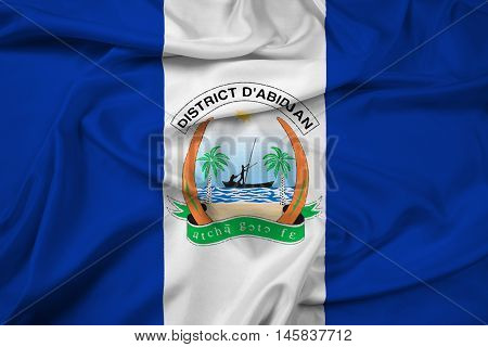Waving Flag of Abidjan Ivory Coast, with beautiful satin background.