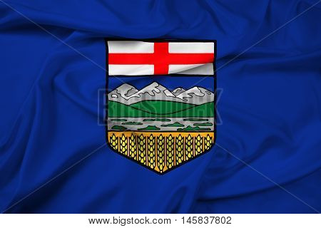 Waving Flag of Alberta Province Canada, with beautiful satin background.