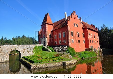 The Cervena Lhota - red castle on water in south bohemia, Czech republic