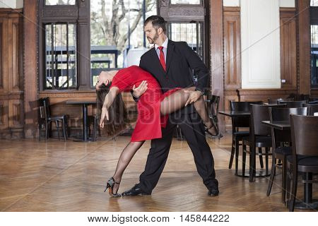 Professional Male And Female Tango Dancers Performing In Restaur