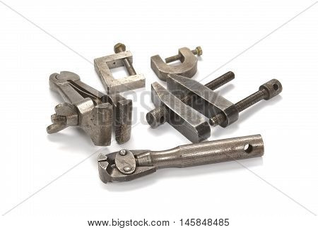 Old screw clamps on a light background close up