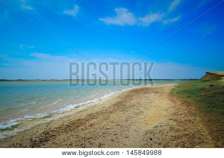 Blue sky over the lake shore. Landscape
