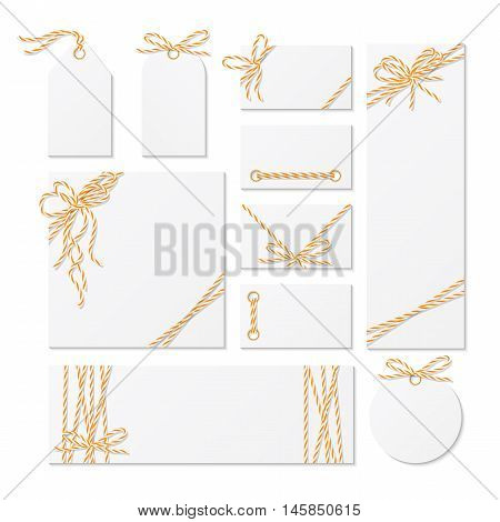 Set of cards, tags and labels tied up with orange bakers twine bows and ribbons