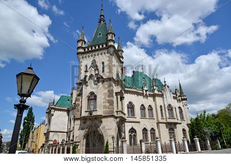 Jakab Palace (Kosice Slovakia) against blue sky and white clouds background.