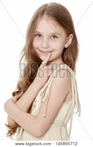 Cute little girl with long brown hair to her waist . The  girl turned sideways to the camera , his hands crossed on his chest. Close-up - Isolated on white background