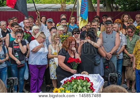 Dnepropetrovsk Ukraine - June 30 2016: Near the morgue building people say goodbye to Ukrainian baritone singer Paris Opera Vasyl Slipak who was killed during the Russian-Ukrainian war in Donbas