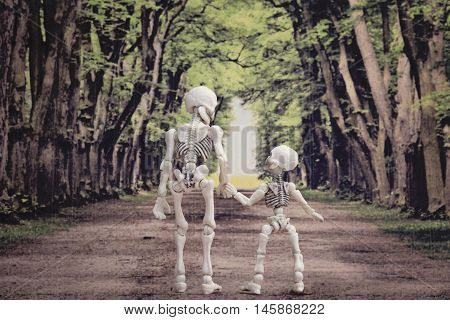 A skeleton and little skeleton walking on a path with trees