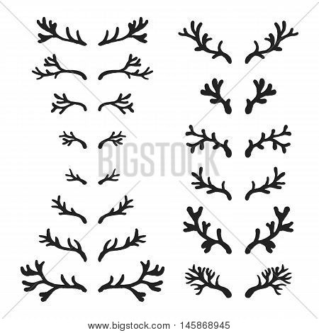 Set of hand drawn deer horns black on the white background, silhouette of antlers.