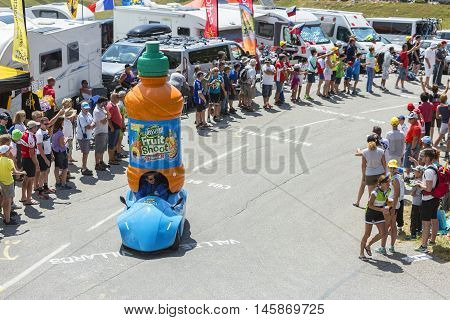 Col du Glandon France - July 23 2015: Teisseire vehicle during the passing of the Publicity Caravan on Col du Glandon in Alps during the stage 18 of Le Tour de France 2015. Teisseire produces fruit juices and syrups for the food service industry.