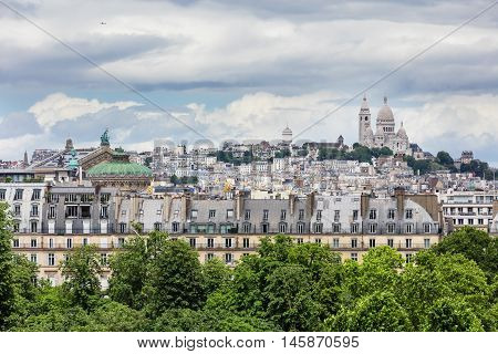 Roofs of Paris with Montmarte hill Basilique du Sacre Coeur and Opera Garnier in background viewed from d'Orsay Museum. Paris France