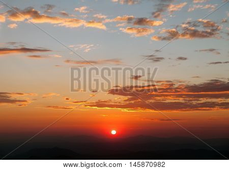 Evening sunset view of beautiful sky with clouds and sun