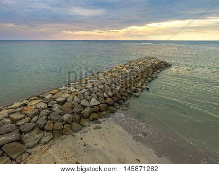 Stone embankment to prevent the waves of the sea