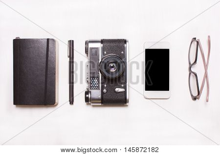 setcollage of men's women's accessories.Collage of men's women's accessories on white background. Phone pencamera vintage notebook glasses. Creative concept creative human hipster designer photographer.Top viewView above