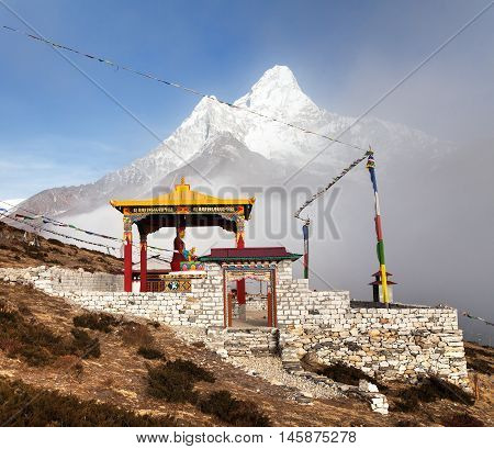 New statue of buddha in Pangboche monastery and mount Ama Dablam Khumbu valley near Tengboche way to Everest base camp Nepal