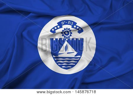 Waving Flag of Bat Yam Israel, with beautiful satin background.
