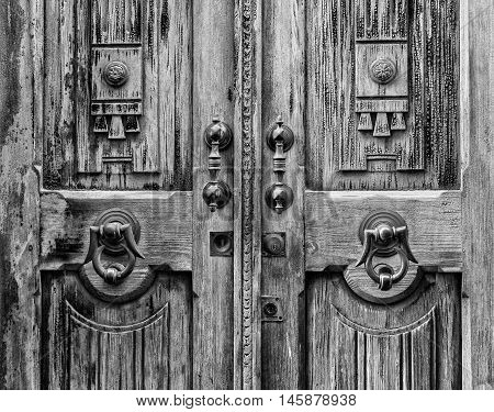 Old Door With Clapper In Black And White