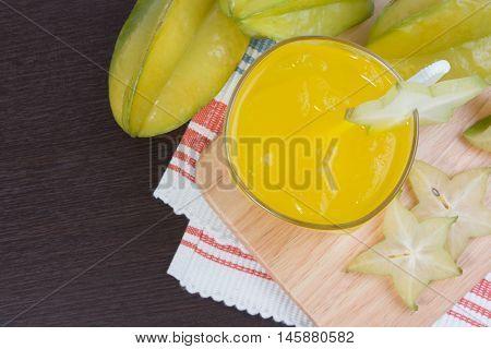Star Apple Juice Or Averrhoa Carambola Squash On Wooden Block. Fresh Star Apple Juice On Wood Table.