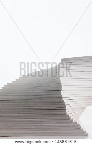 stack of new published magazines isolated against a white background