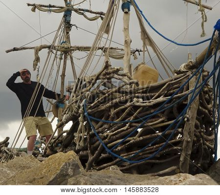 HOYLAKE, ENGLAND, JUNE 24. The Grace Darling on June 24, 2016, in Hoylake, England. A tourist steers on the deck of the Grace Darling pirate ship art installation in Hoylake England.