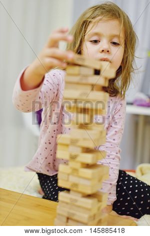 Little Girl With Wooden Blocks