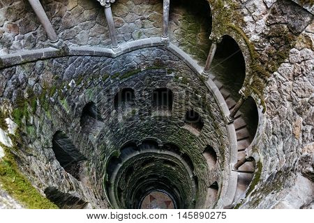 Initiation Wells. Deep well in the territory of Quinta da Regaleira. Old spiral staircase goes down.