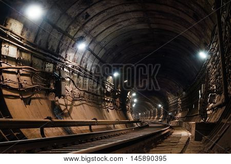 circular subway tunnel with light turn left.