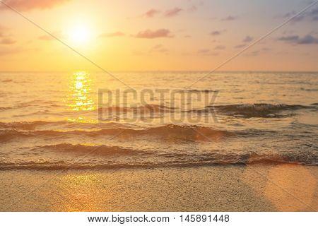 Golden sunset on the sea beach.