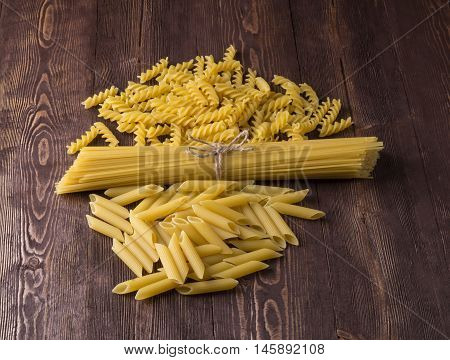 Pasta With Different Types Of Italian Pasta. Uncooked Pasta  On The Table. Mixed Dried Pasta Selecti