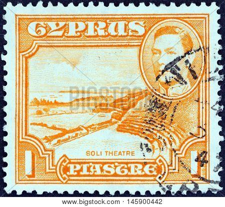 CYPRUS - CIRCA 1938: A stamp printed in Cyprus shows Roman theatre, Soli and King George VI, circa 1938.