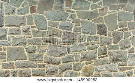 rock background stone wall of ancient fieldstone house