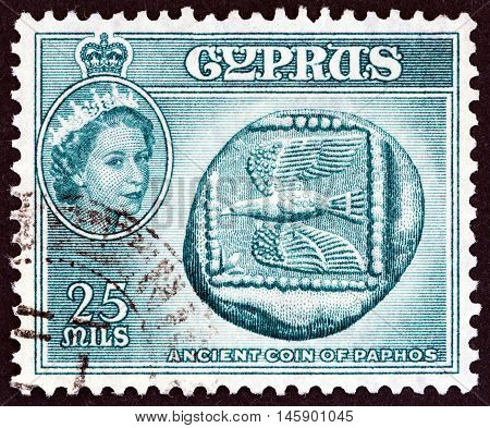 CYPRUS - CIRCA 1955: A stamp printed in Cyprus shows Ancient coin of Paphos (5th century B.C.) and Queen Elizabeth II, circa 1955.