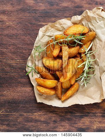 slices of fried potatoes with rosemary and spices