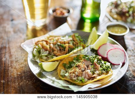 two mexican street tacos with chopped pork and Chicharr�³n