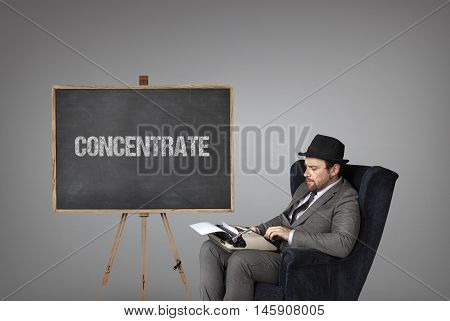 Concentrate text on  blackboard with businessman and key