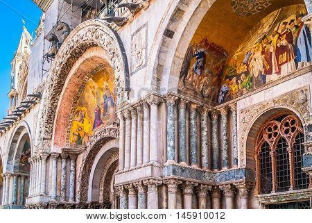 Marble architecture in Venice city, view at cathedral facade with architecture details, Venice Italy.