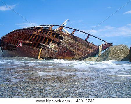 Shipwreck on a beach after a storm.