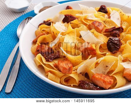 Italian Fettuccine pasta with salmon parmesan and dried tomatoes