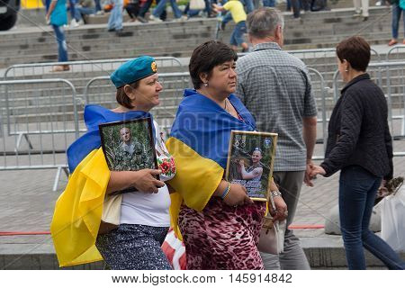 Kiev Ukraine - August 24 2016: Mothers with pictures of those killed in the zone of the antiterrorist operation soldiers after the parade on Independence Square