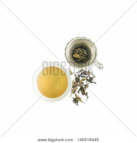 Closeup beautiful ceramic cup of tea with brown tea and dried tea leave in tea strainer isolated on with background in top view