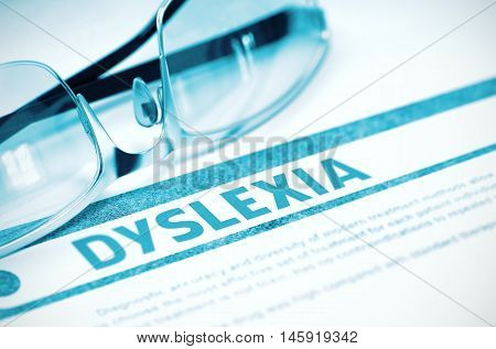 Dyslexia - Printed Diagnosis on Blue Background and Glasses Lying on It. Medicine Concept. Blurred Image. 3D Rendering.